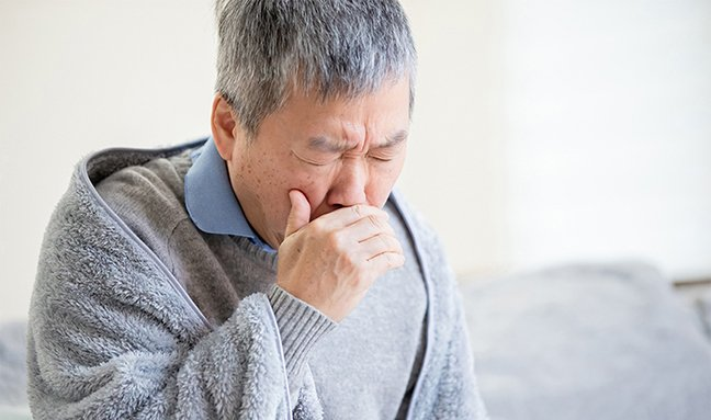 Older person coughing